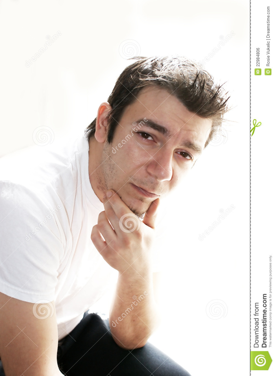 Uncertain man in white shirt royalty free stock image for Man in white shirt
