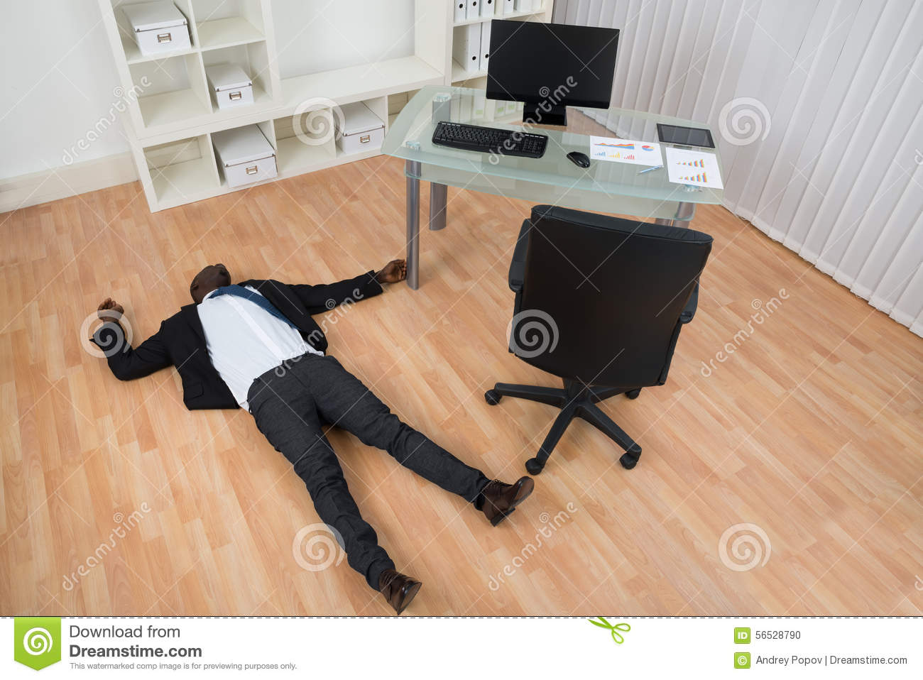 Unconscious businessman lying on floor stock photo image for On the floor