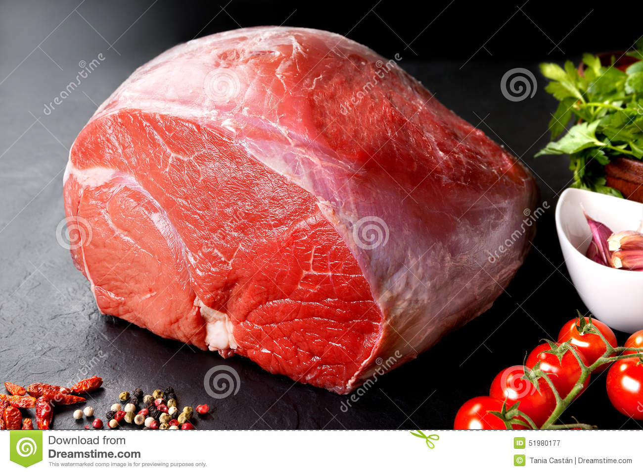 Uncooked fresh pork and beef. Piece of raw red meat with black background