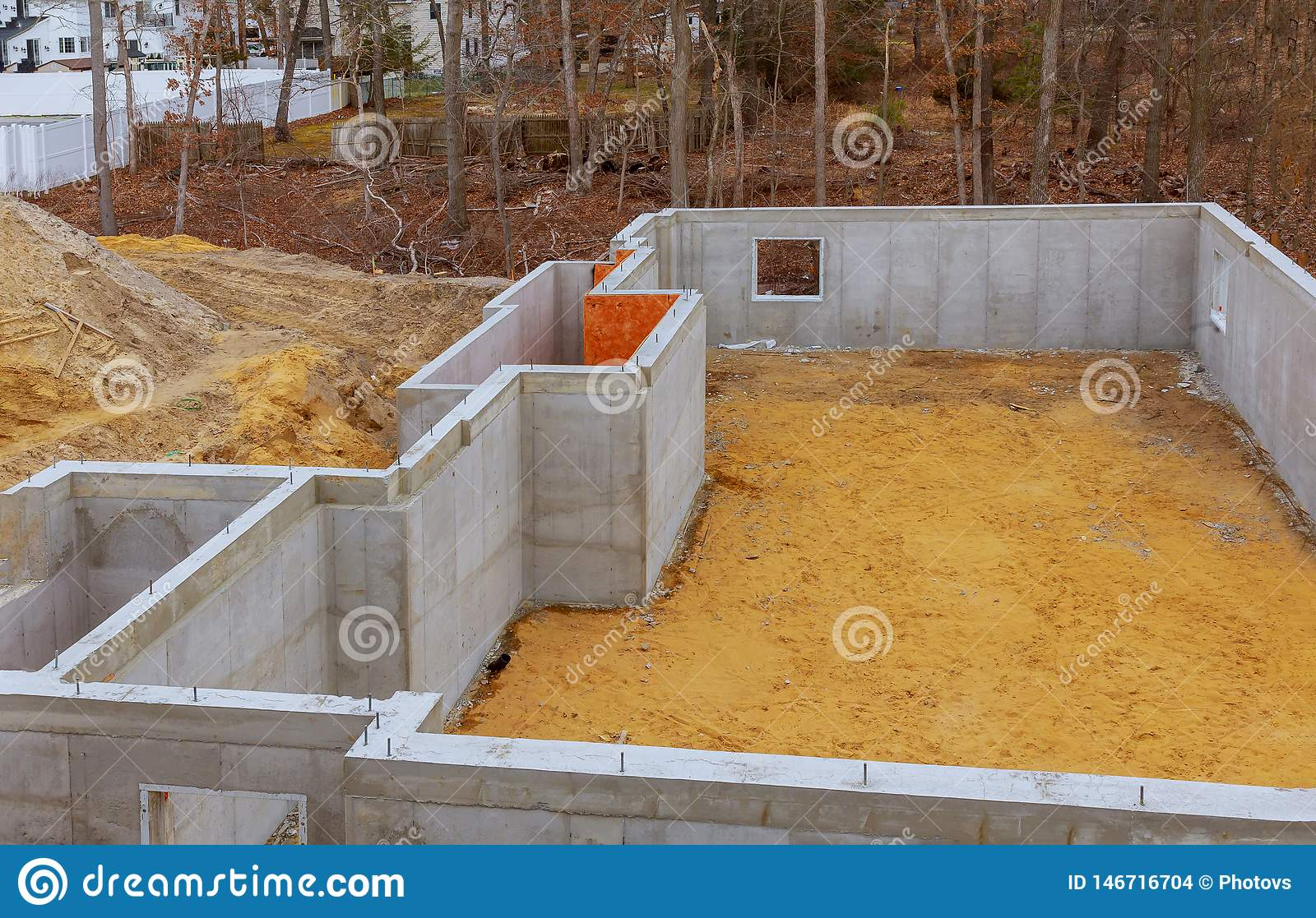 Under construction foundation new home with cement