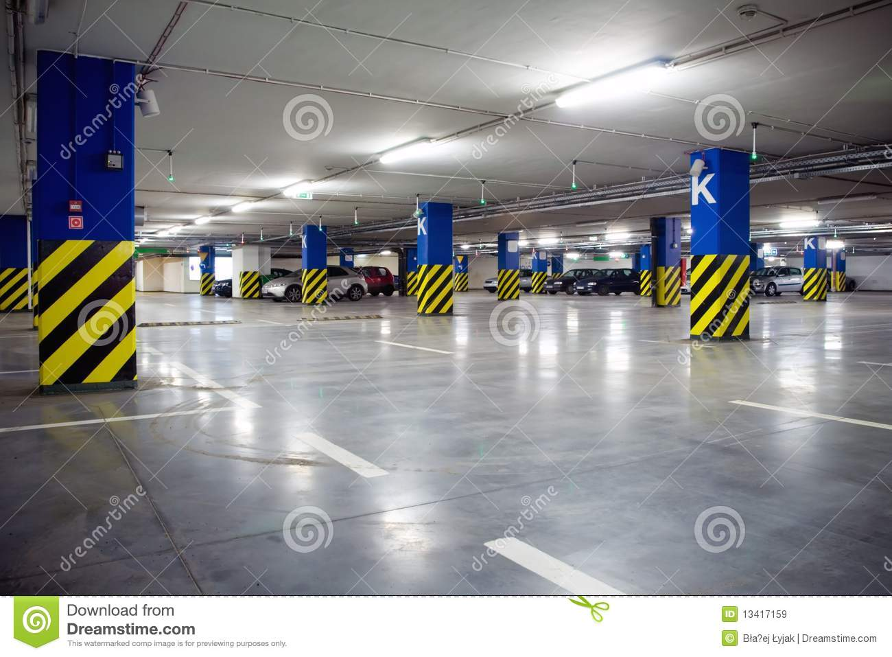 Underground parking garage with cars