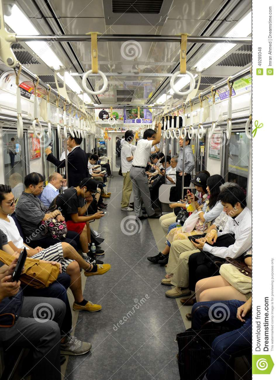 Underground Subway Train Carriage With People In Tokyo