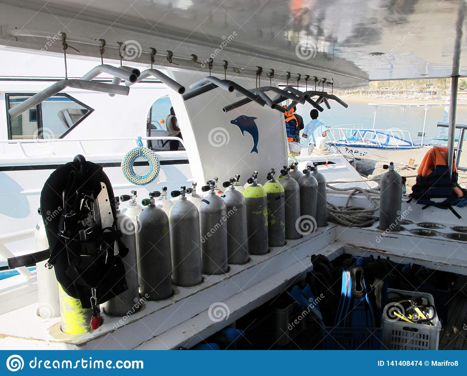 Underwater diving equipment. Many diving cylinders. Boat to sail