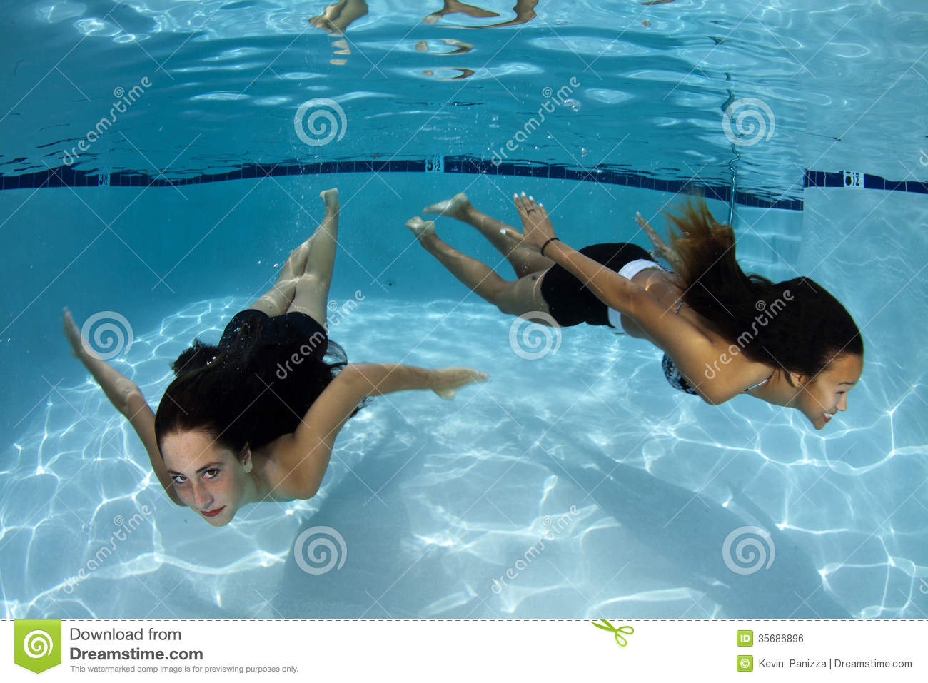 Teen girls underwater you abstract