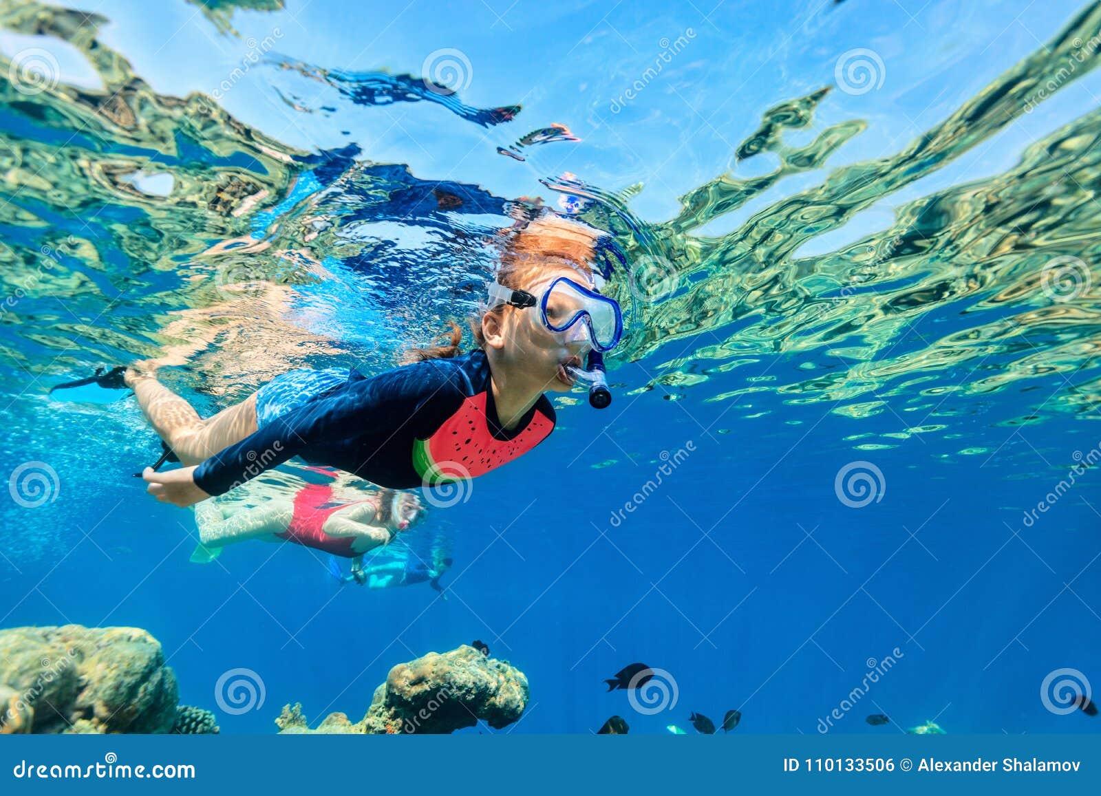 Family snorkeling in ocean