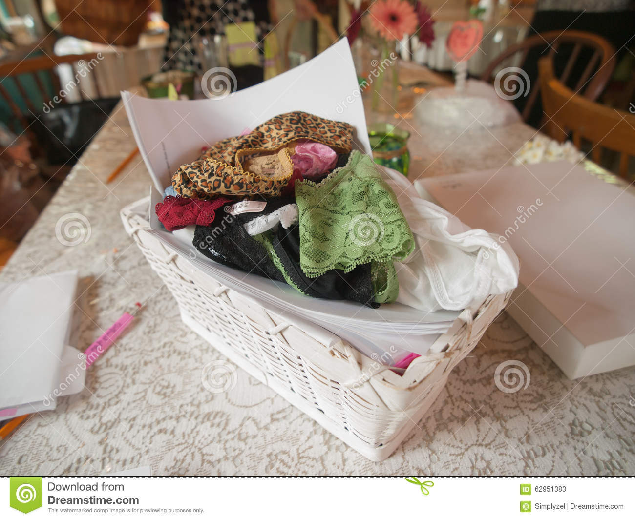 basket of a variety of styles of clean underwear on a table for a game at a bridal shower