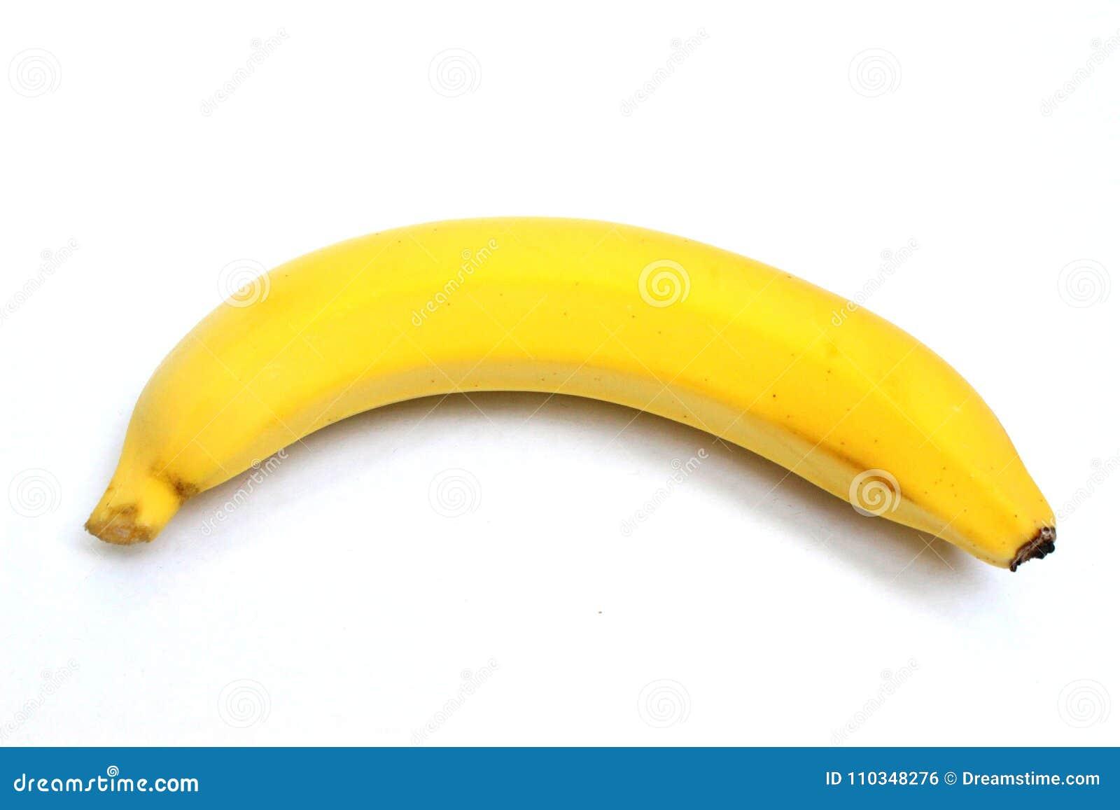 Une banane jaune sur la vue supérieure à l arrière-plan blanc