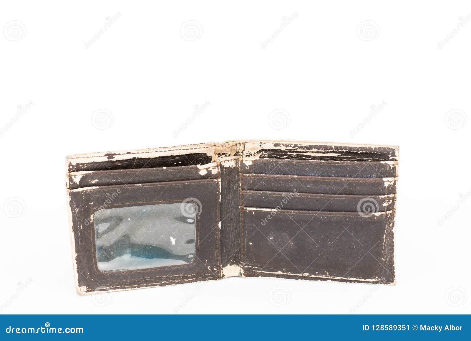 Une photo d un vieux portefeuille en cuir brun