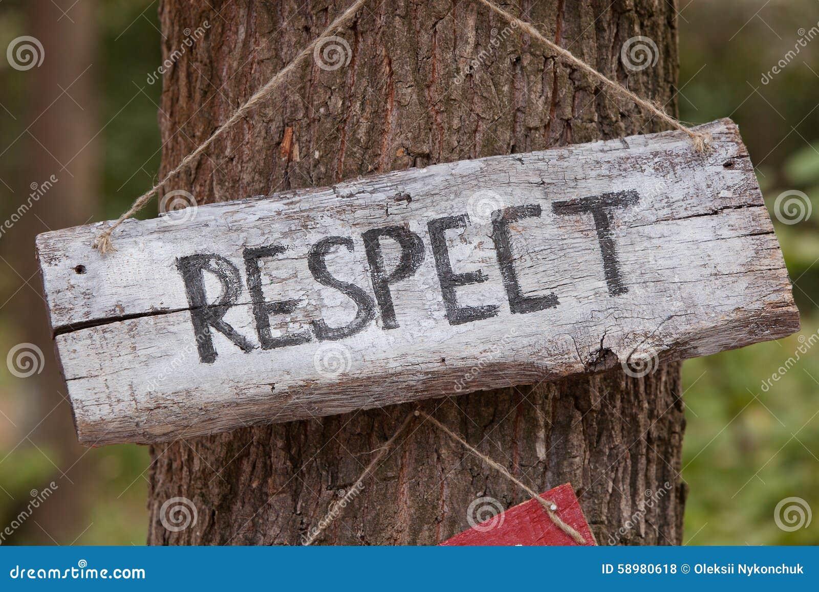 Une plaque en bois avec le respect de mot