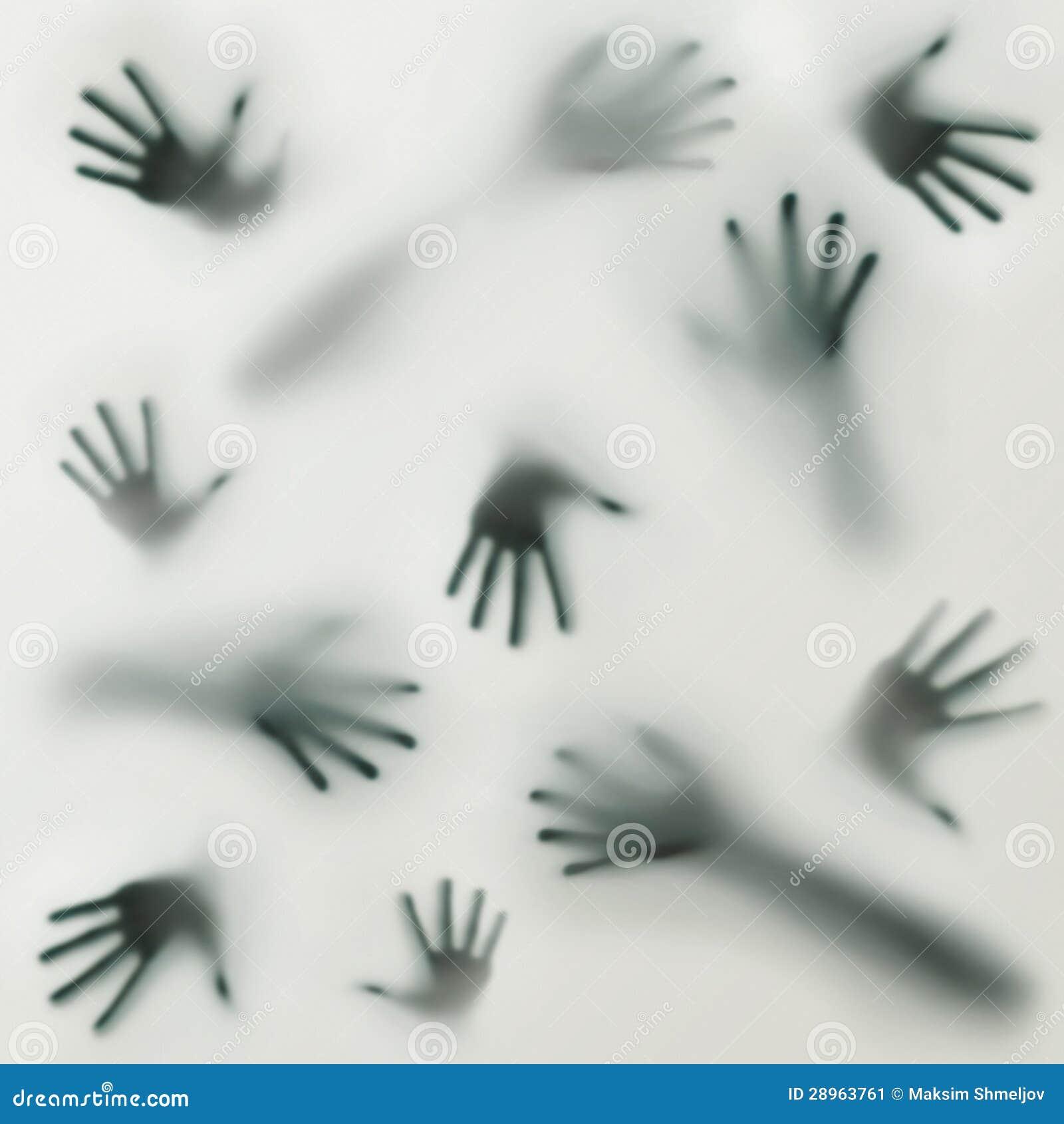 Une silhouette effrayante de beaucoup de différentes mains