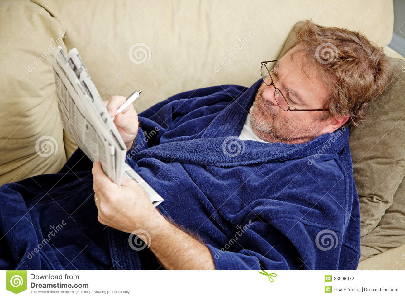 Unemployed Checking Classified Ads for Work
