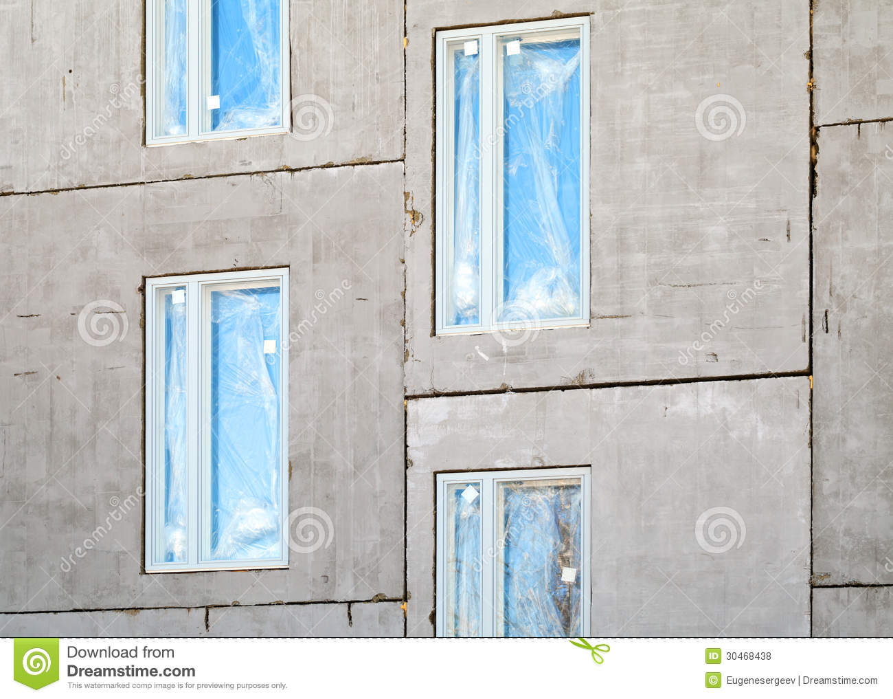Concrete Building With Windows : Unfinished building concrete wall with windows stock photo