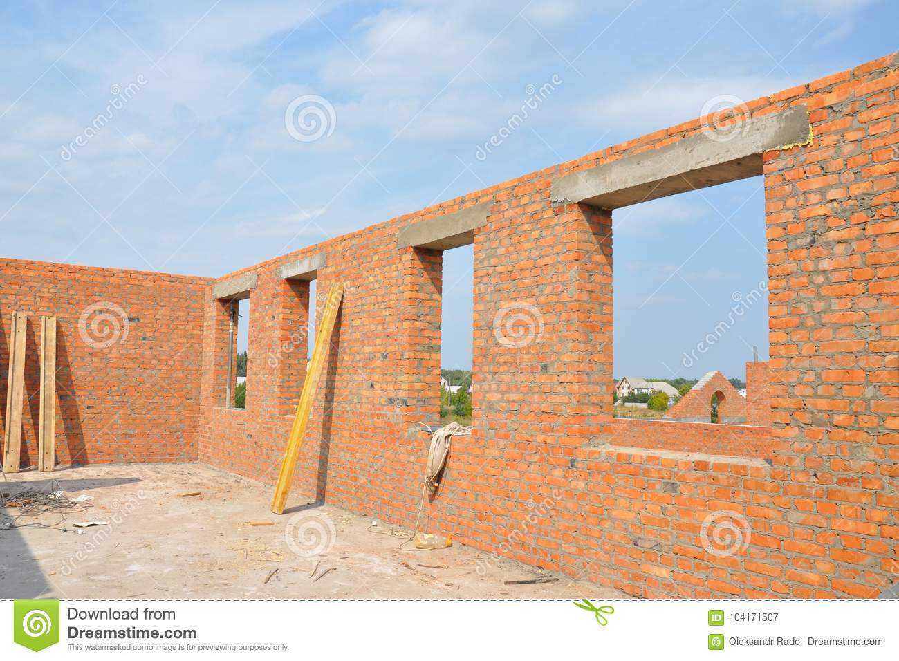 Unfinished Red Brick House Wall Under Construction Without Roofing