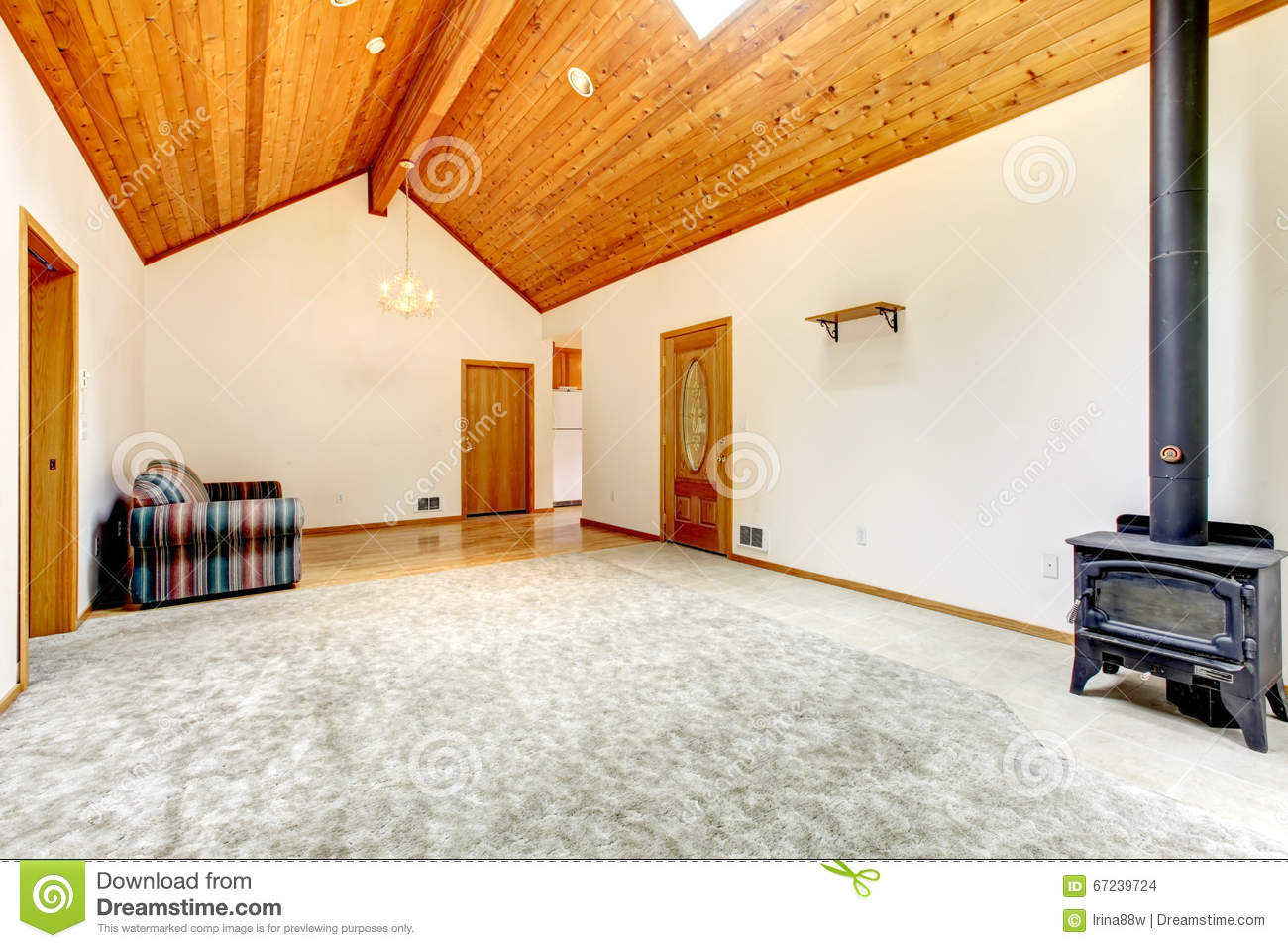 Unfurnished living room with carpet wood burning stove and vaulted wood ceiling stock photo for Living room with wood burning stove
