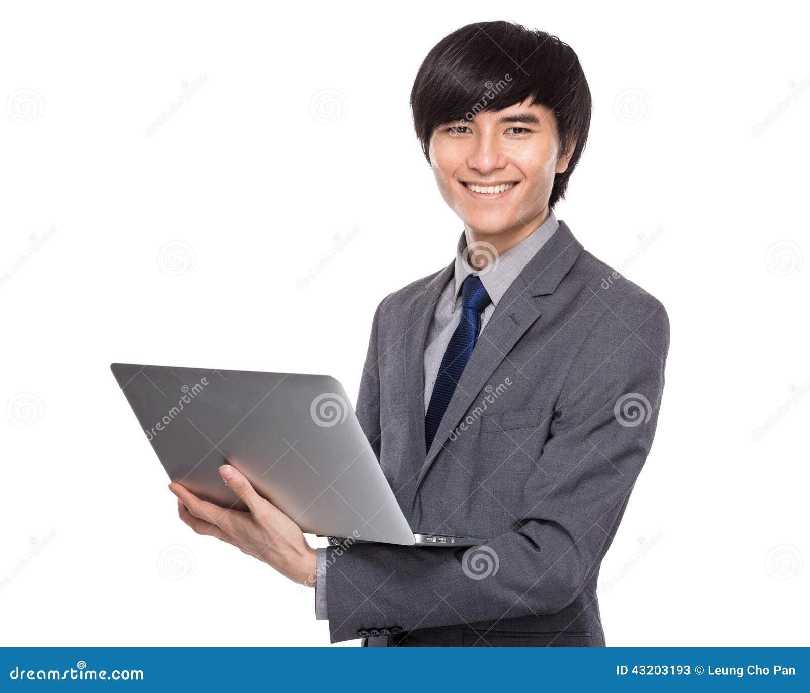 Download Ung Dator För Affärsmanbruksanteckningsbok Fotografering för Bildbyråer - Bild av korean, håll: 43203193