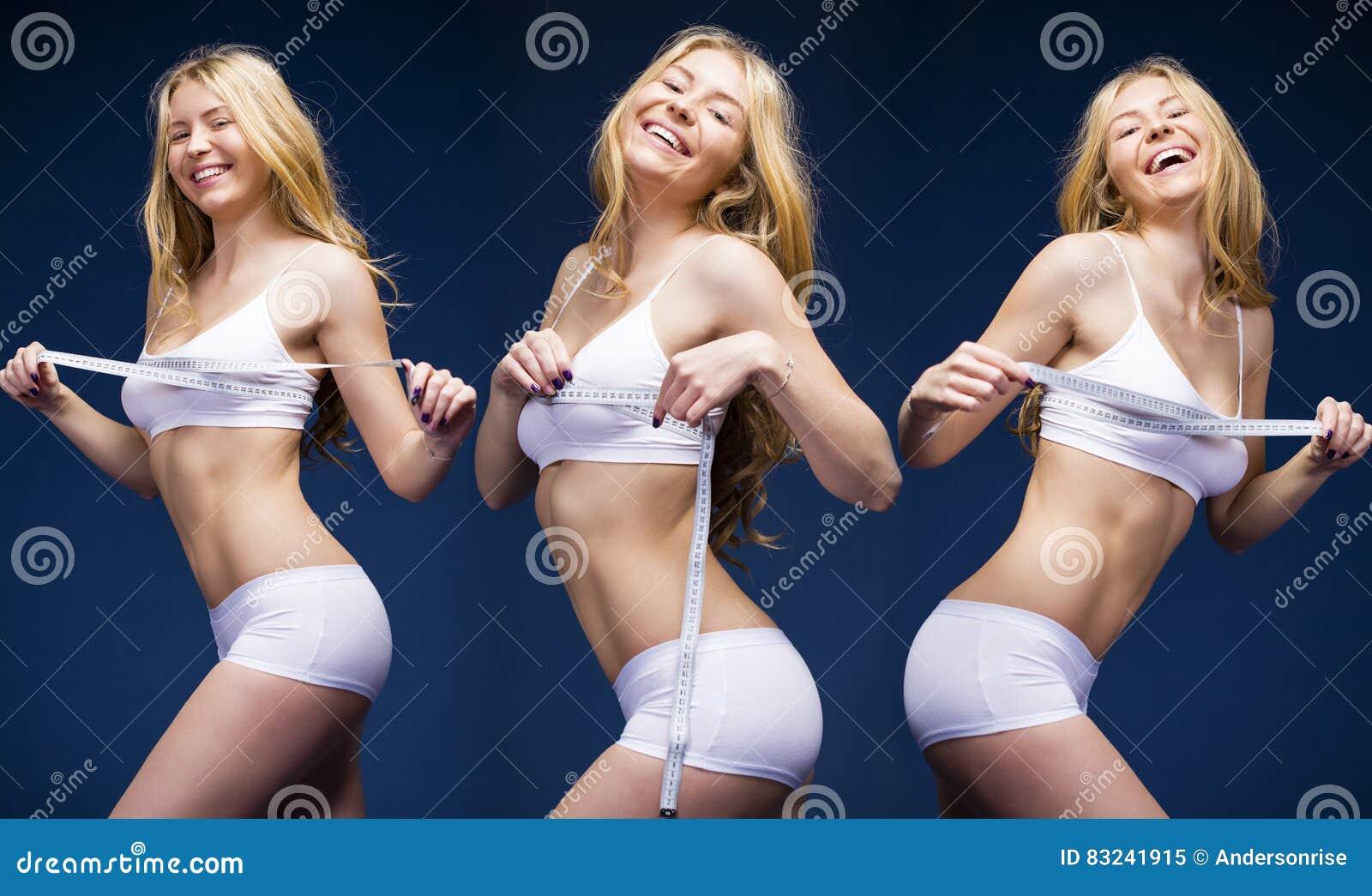 Ung härlig blond kvinna i vita konditionkläder