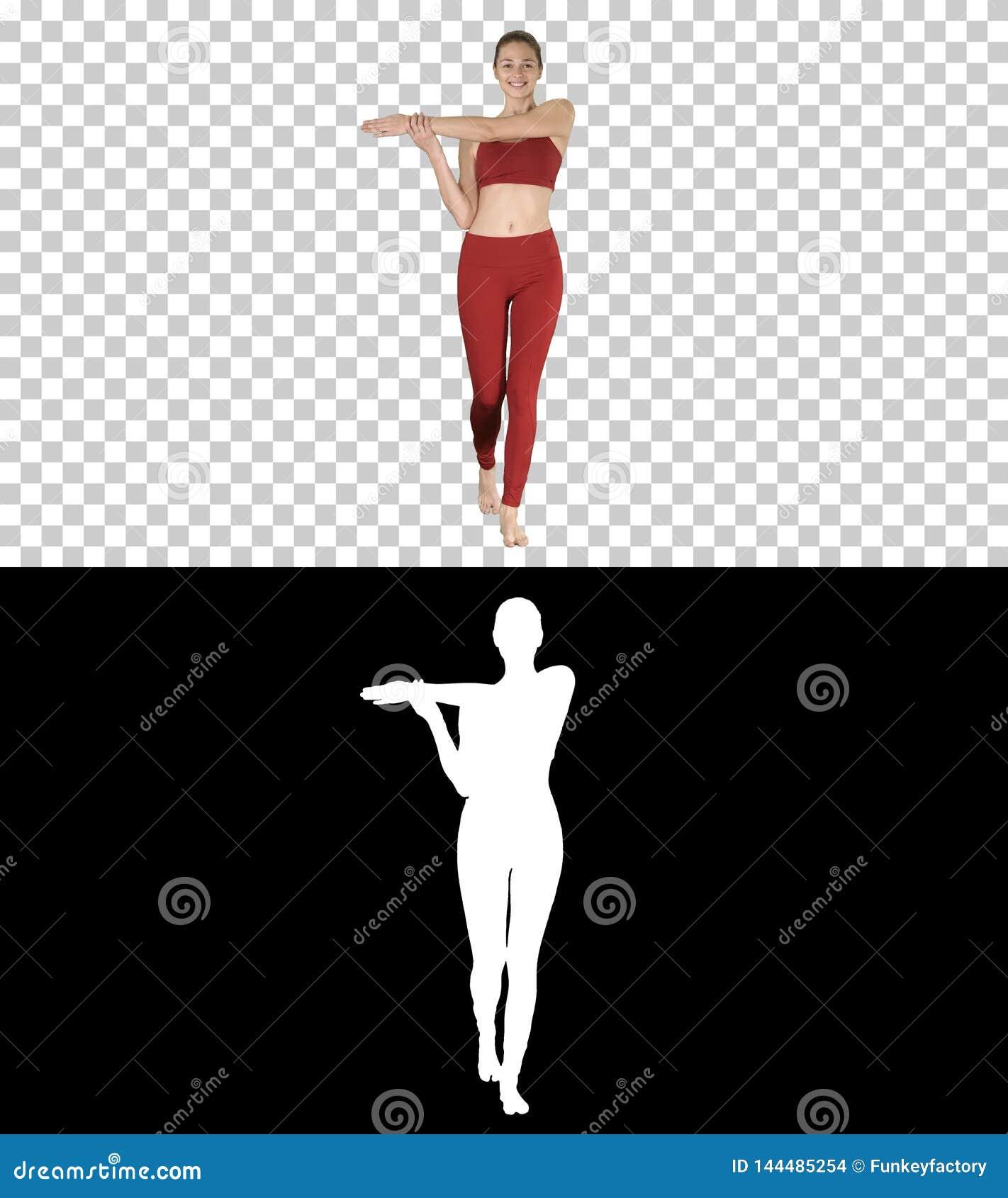 Ung kvinna som sträcker händer i yogaklänningen, Alpha Channel