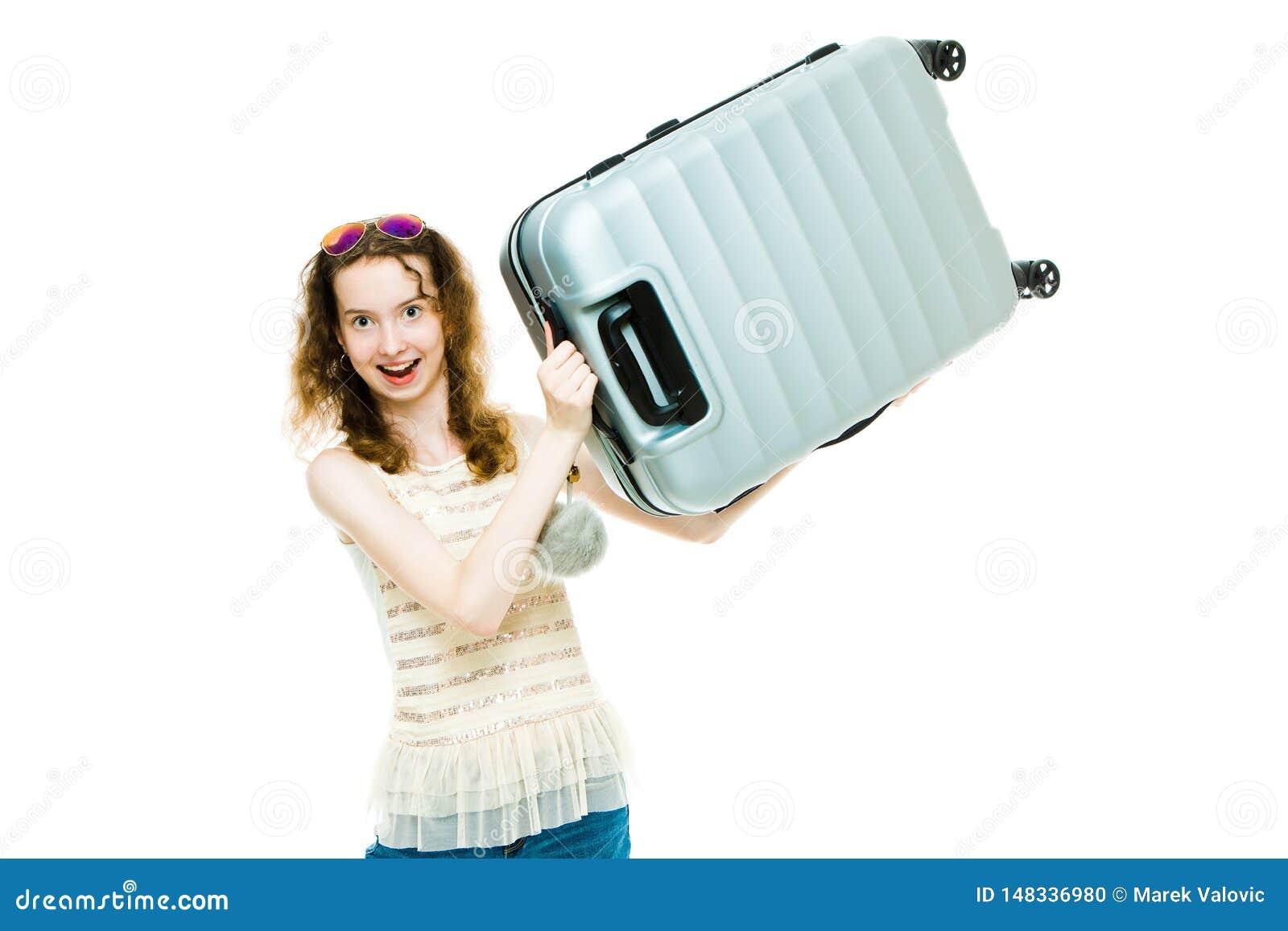 Ung mager flicka som rymmer plast- bagage