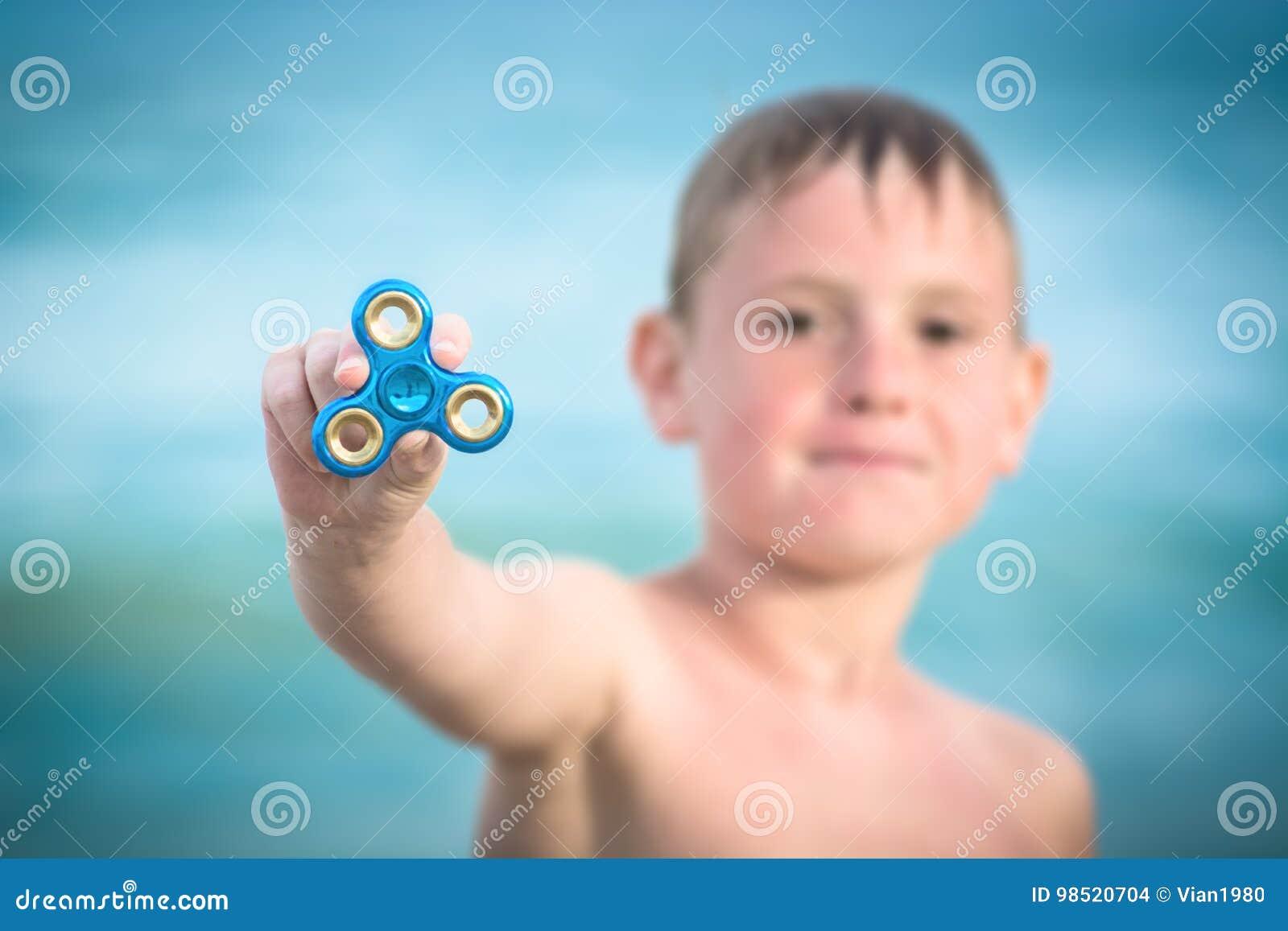 Ung pojke och spinnare