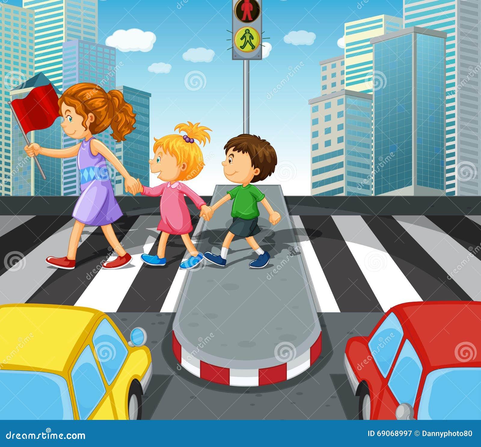 Ungar som korsar vägen på zebramarkeringen