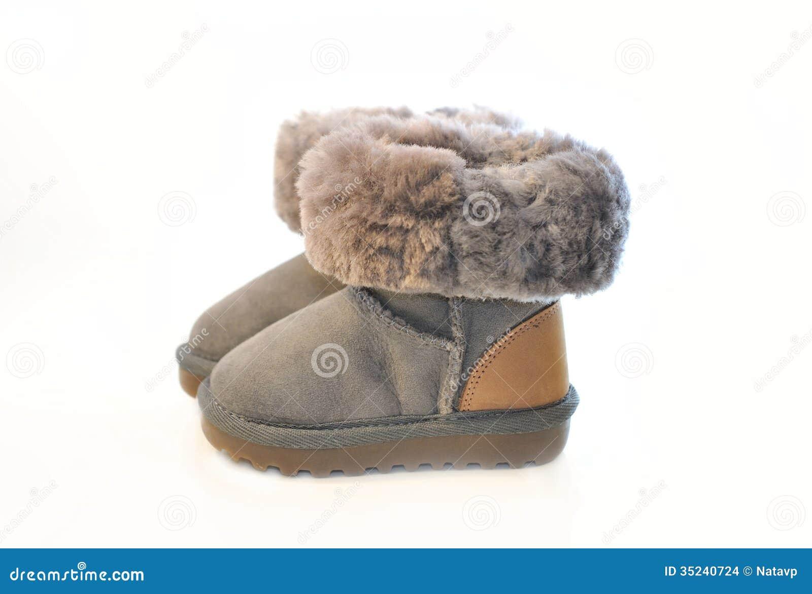 Ungar Värme Vinterkängor Med Isolerad Päls Fotografering för