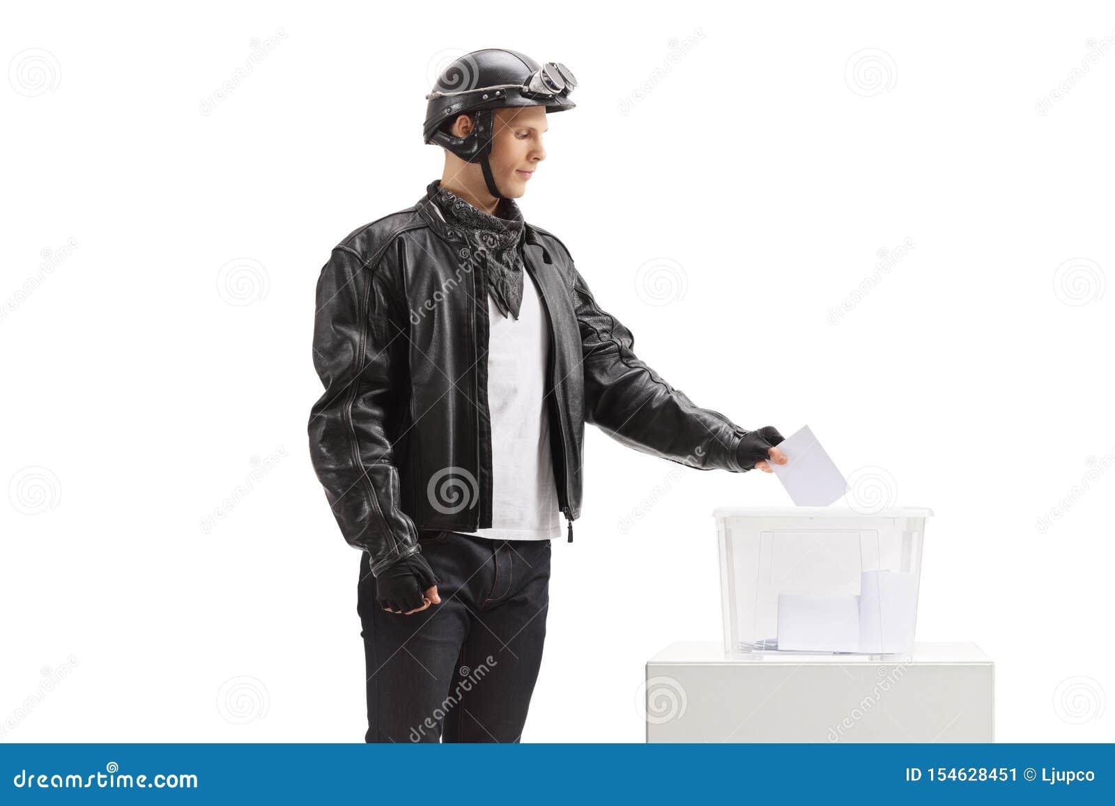 Ungt gjuta för cyklist röstar in i en valurna