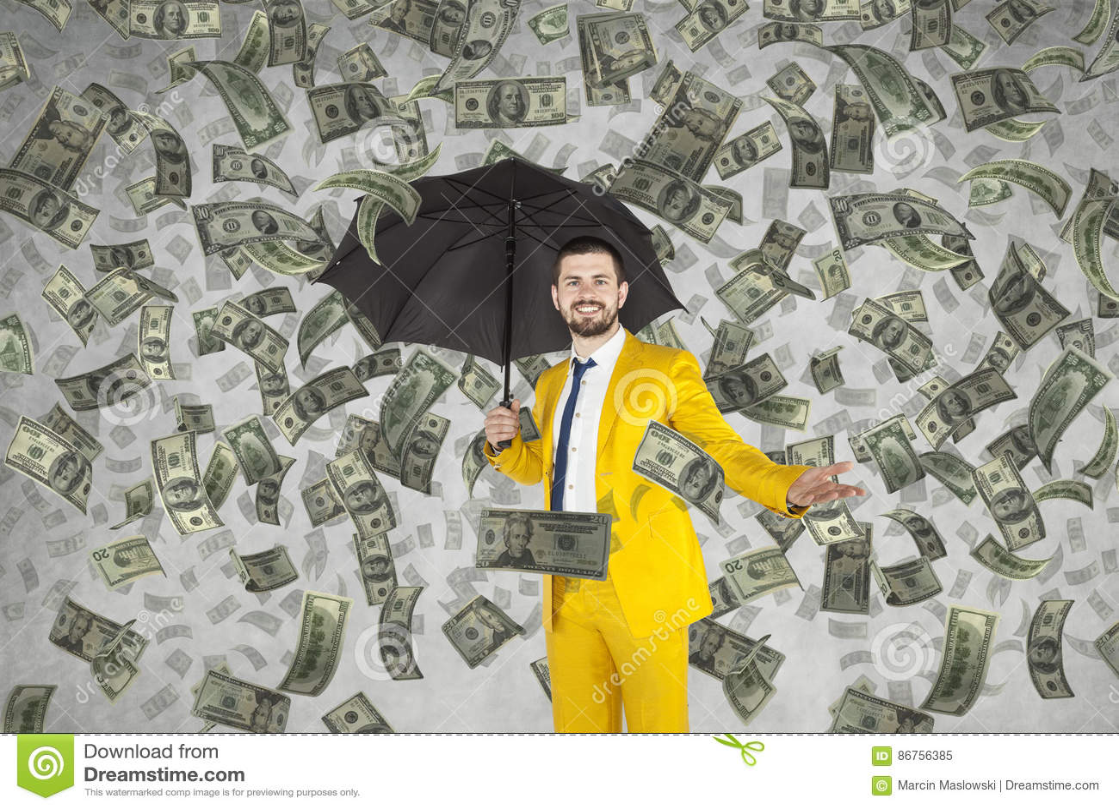 Ungt rikt affärsmananseende i pengarregn