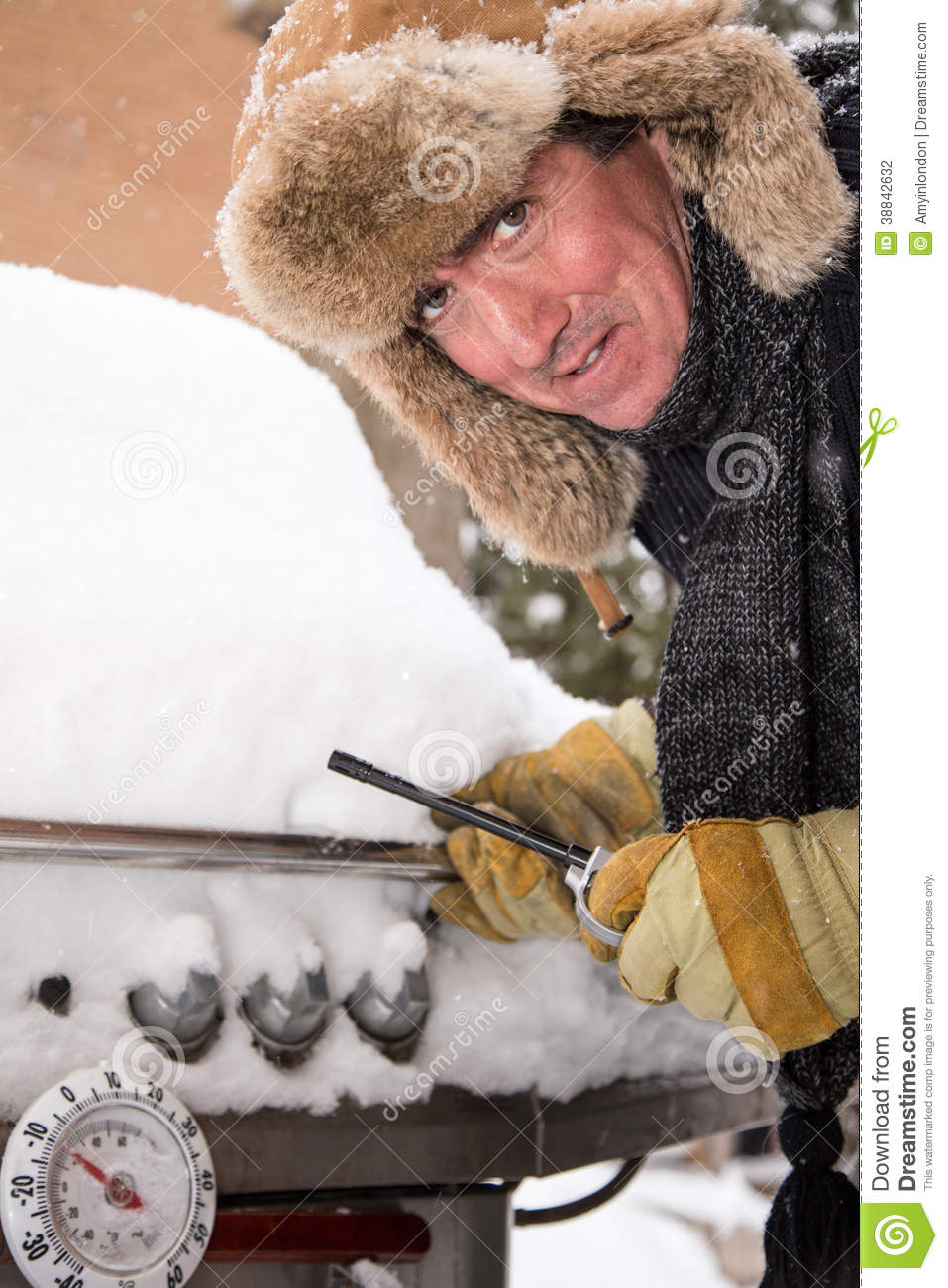 Unhappy Barbeque Guy In Snow Stock Photo