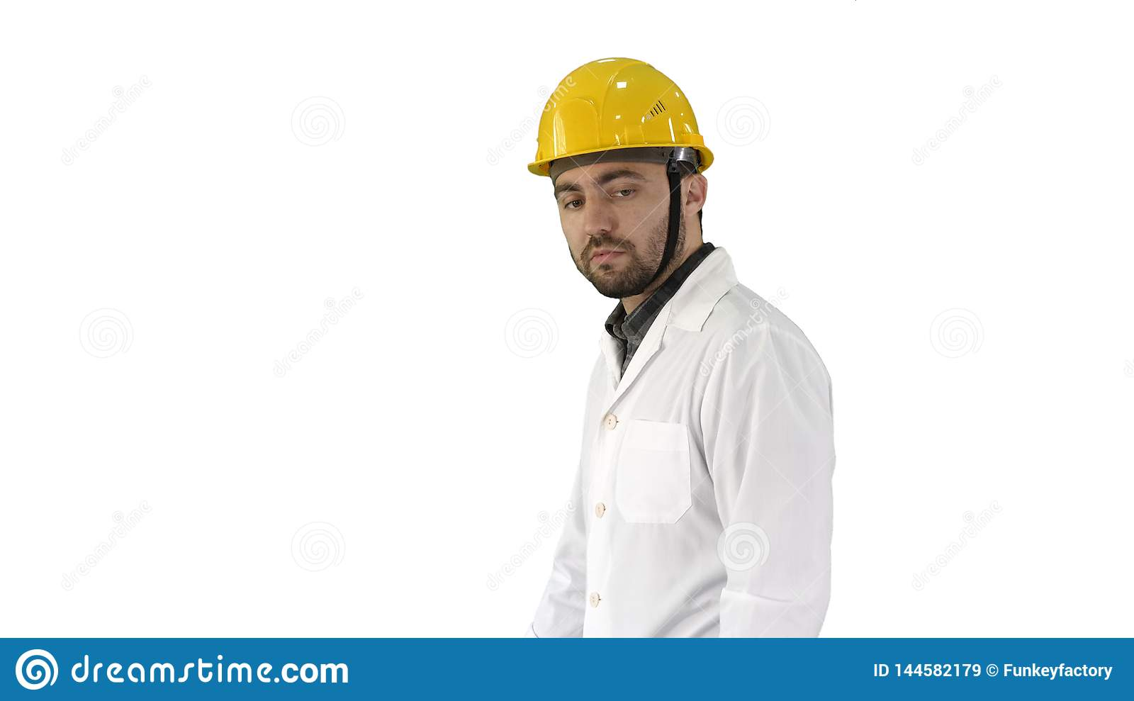 Unhappy construction site engineer talking and walking on white background.