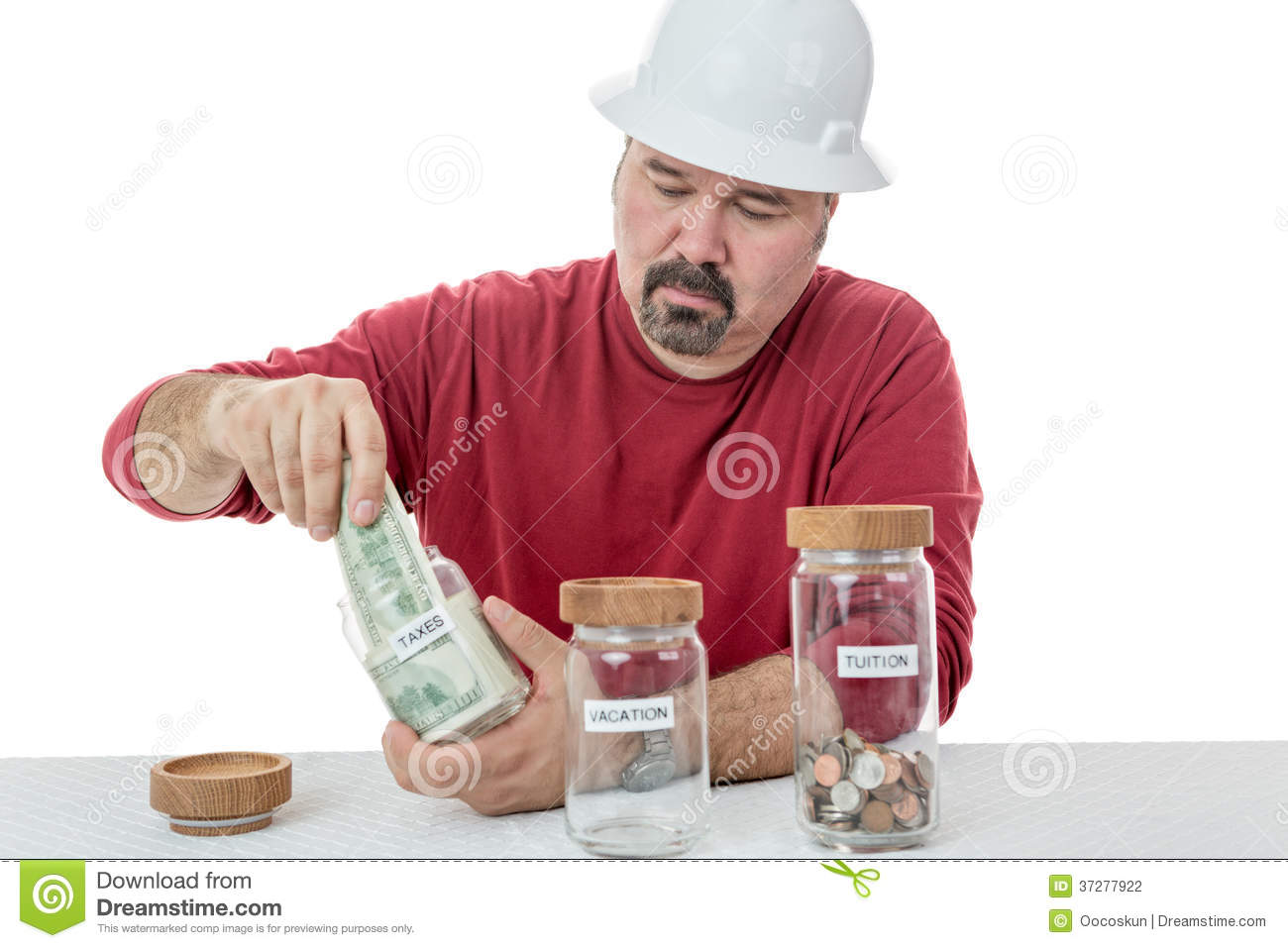 Unhappy Construction Worker Paying The Taxes Stock