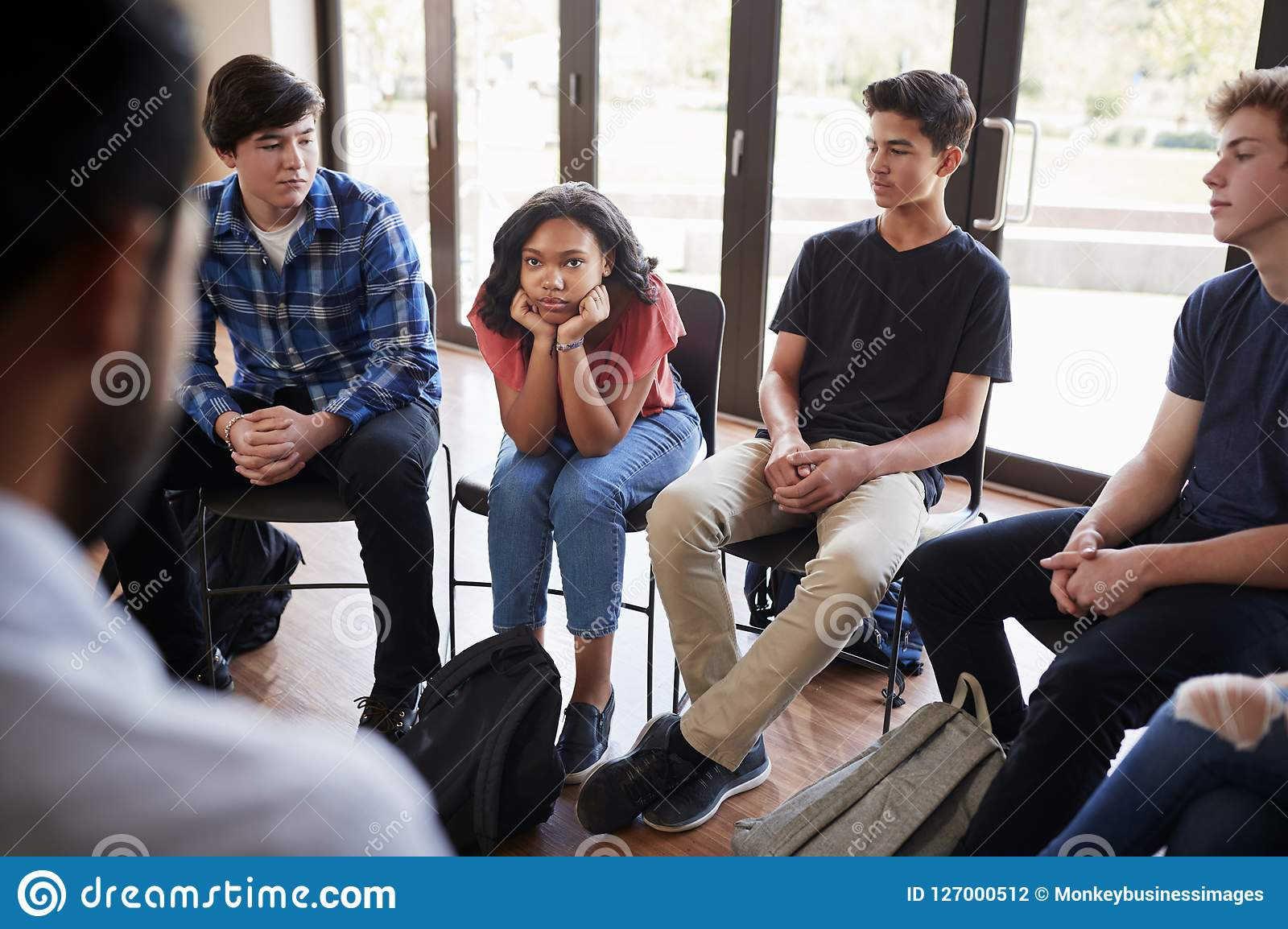 Unhappy Female Pupil In High School Discussion Group