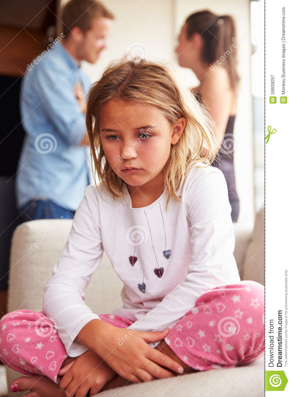 Unhappy Girl At Home With Parents Arguing In Background