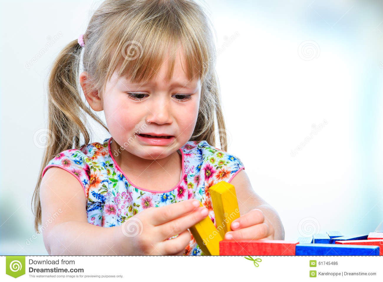 Unhappy Little Girl Playing With Wooden Blocks. Stock ...