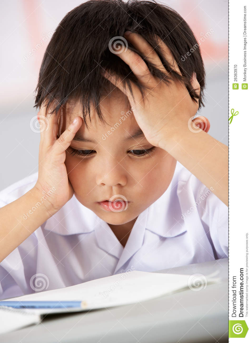 Unhappy Male Student Working At Desk Stock Photo - Image ...