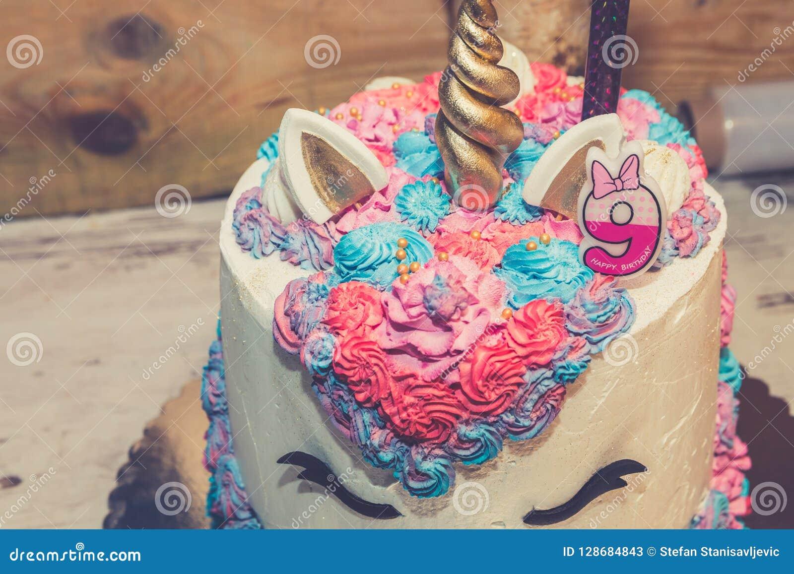 Unicorn birthday cake stock image. Image of eyes, girls - 128684843
