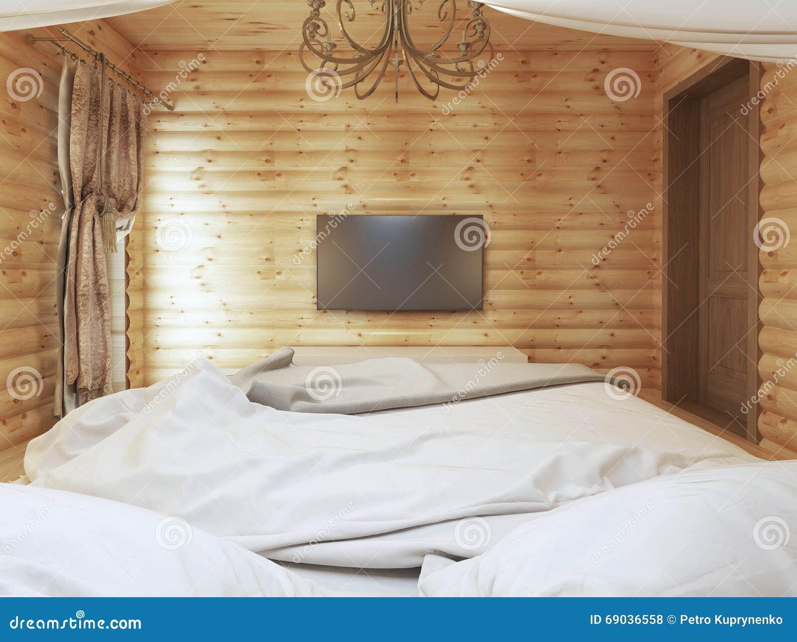 Unidade da tevê em um interior moderno do quarto em um log