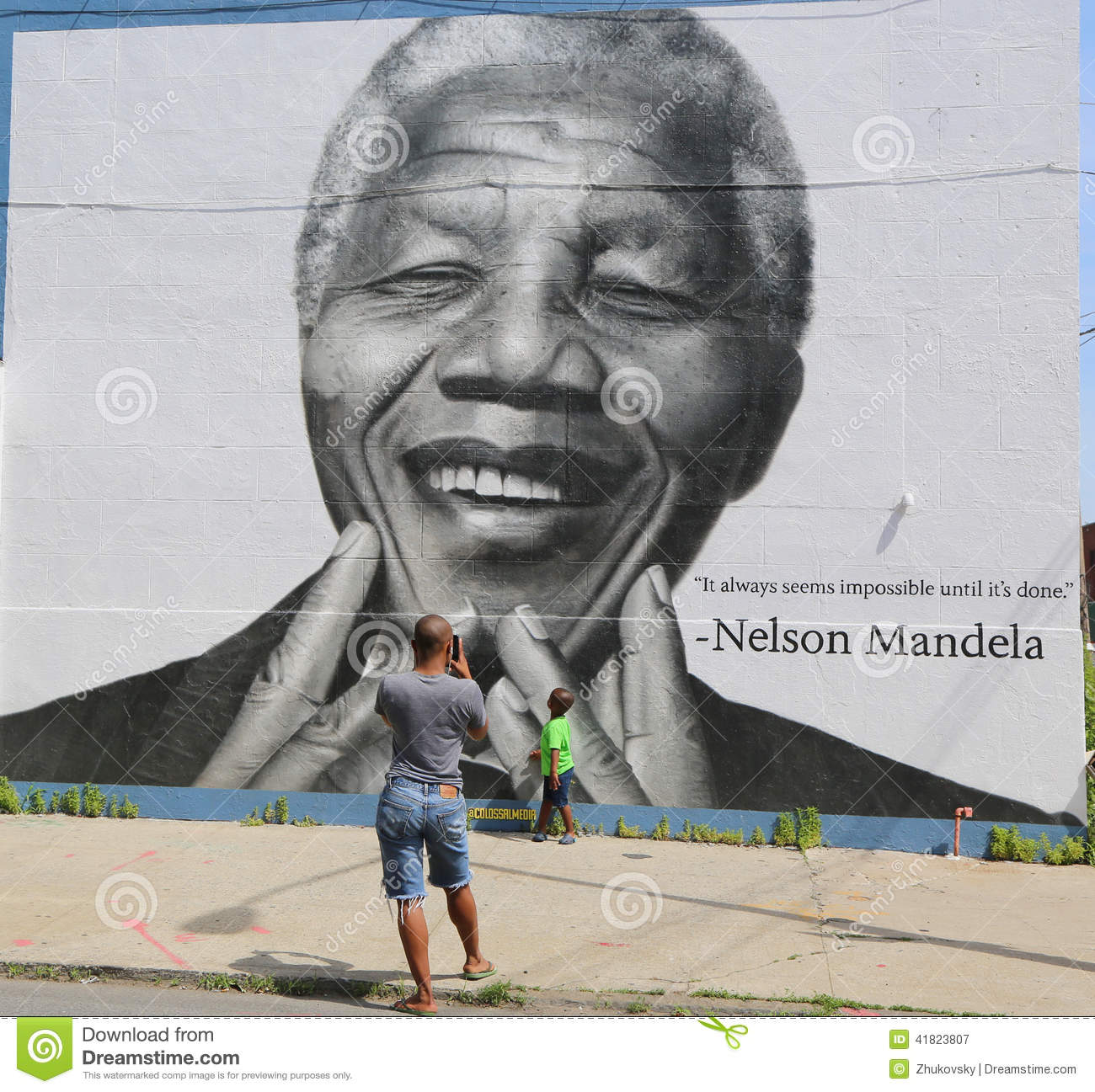 Unidentified family taken picture in the front of Nelson Mandela mural in Williamsburg section in Brooklyn