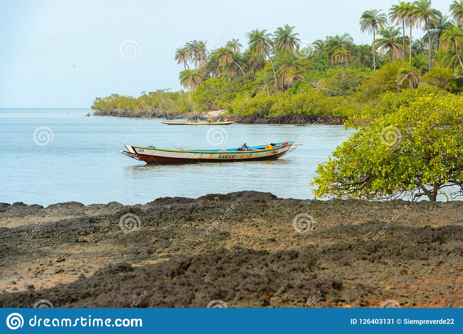 Unidentified local man sails on the boat on the coast of the So