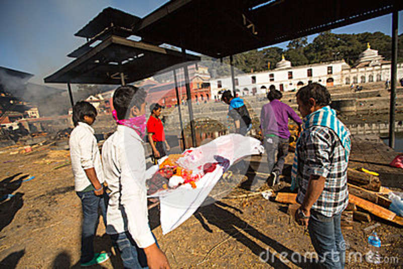 Unidentified local people during the cremation ceremony along the holy Bagmati River in Bhasmeshvar Ghat