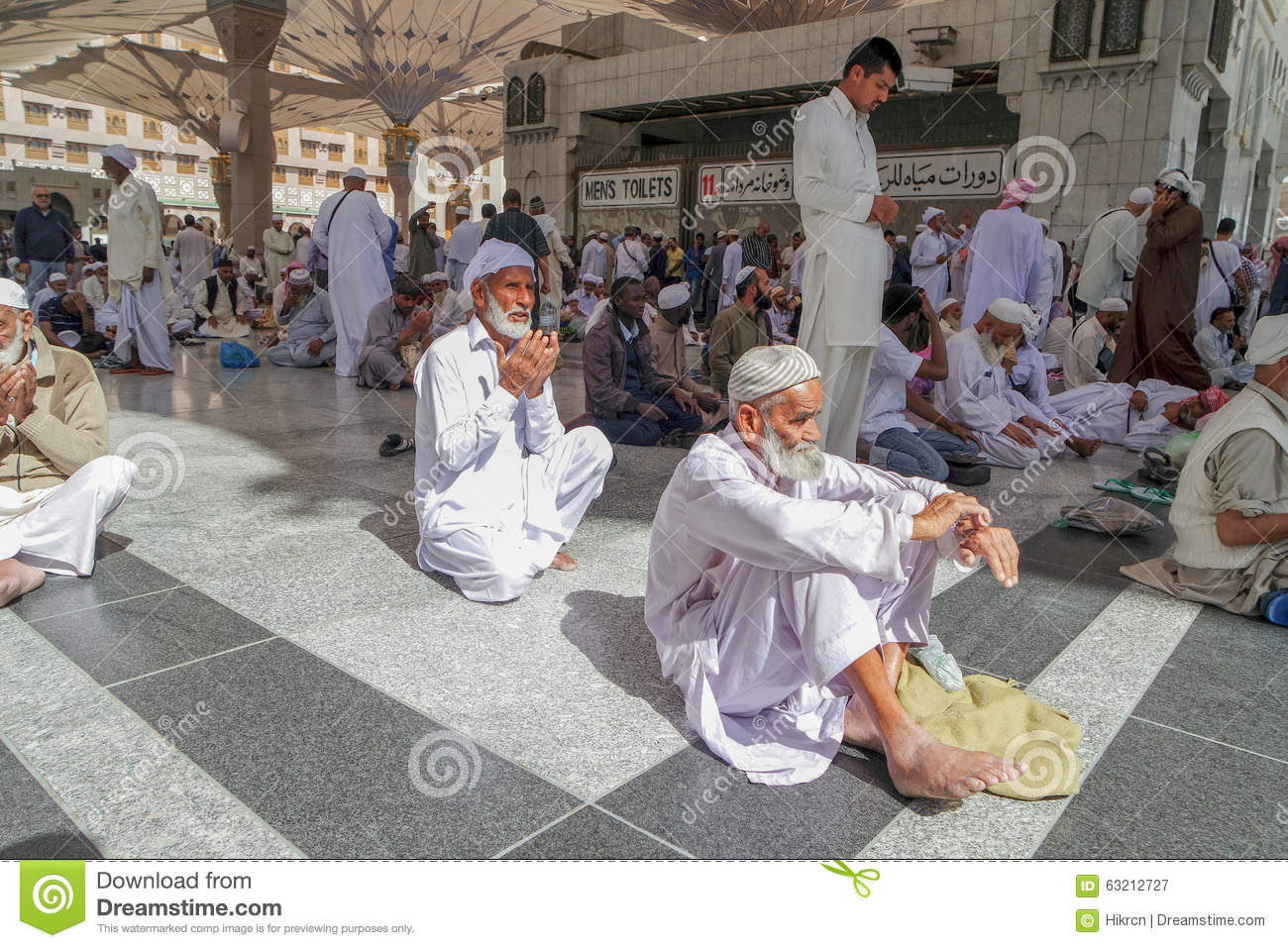 Unidentified People Are Reciting Doa And Al-Quran At The