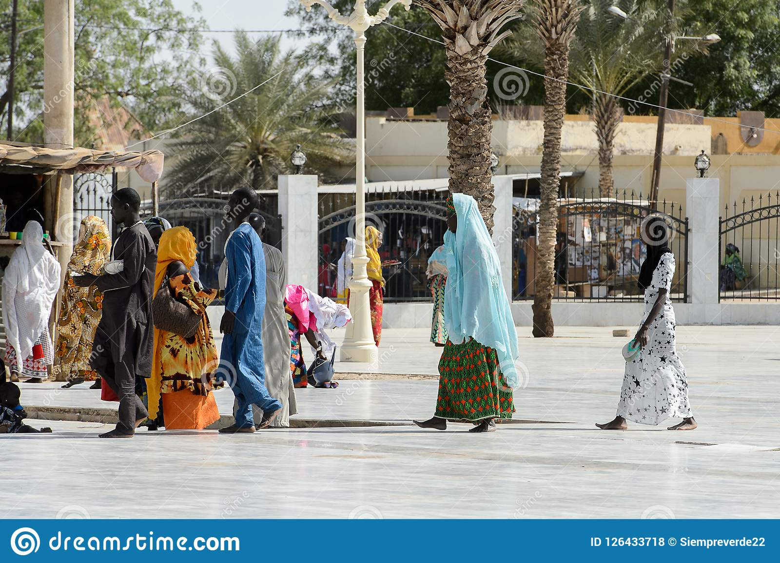Unidentified Senegalese People In Colored Traditional
