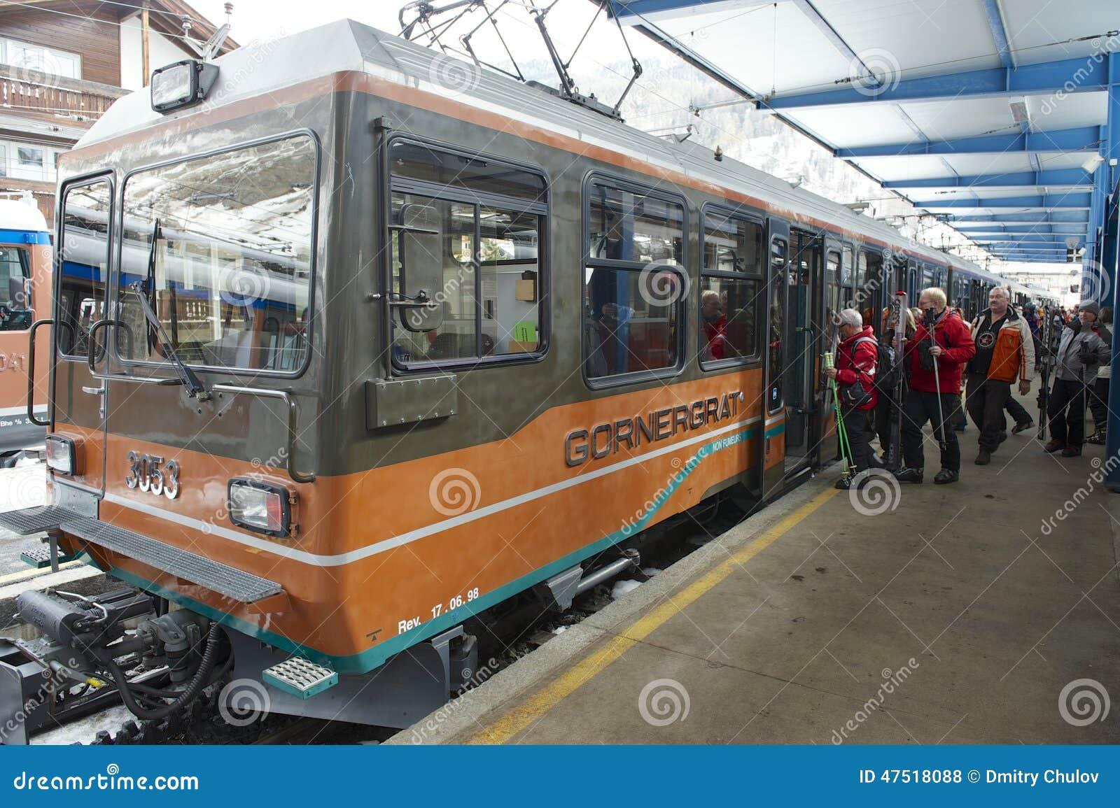 Unidentified skiers embark Gornergrat train at Zermatt station, Switzerzland.