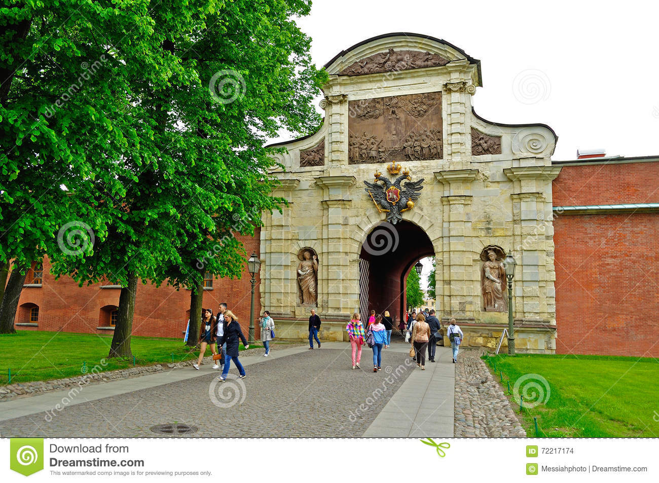 Unidentified tourists at the entrance of Peter`s Gate in territory of Peter and Paul Fortress in Saint-Petersburg, Russia