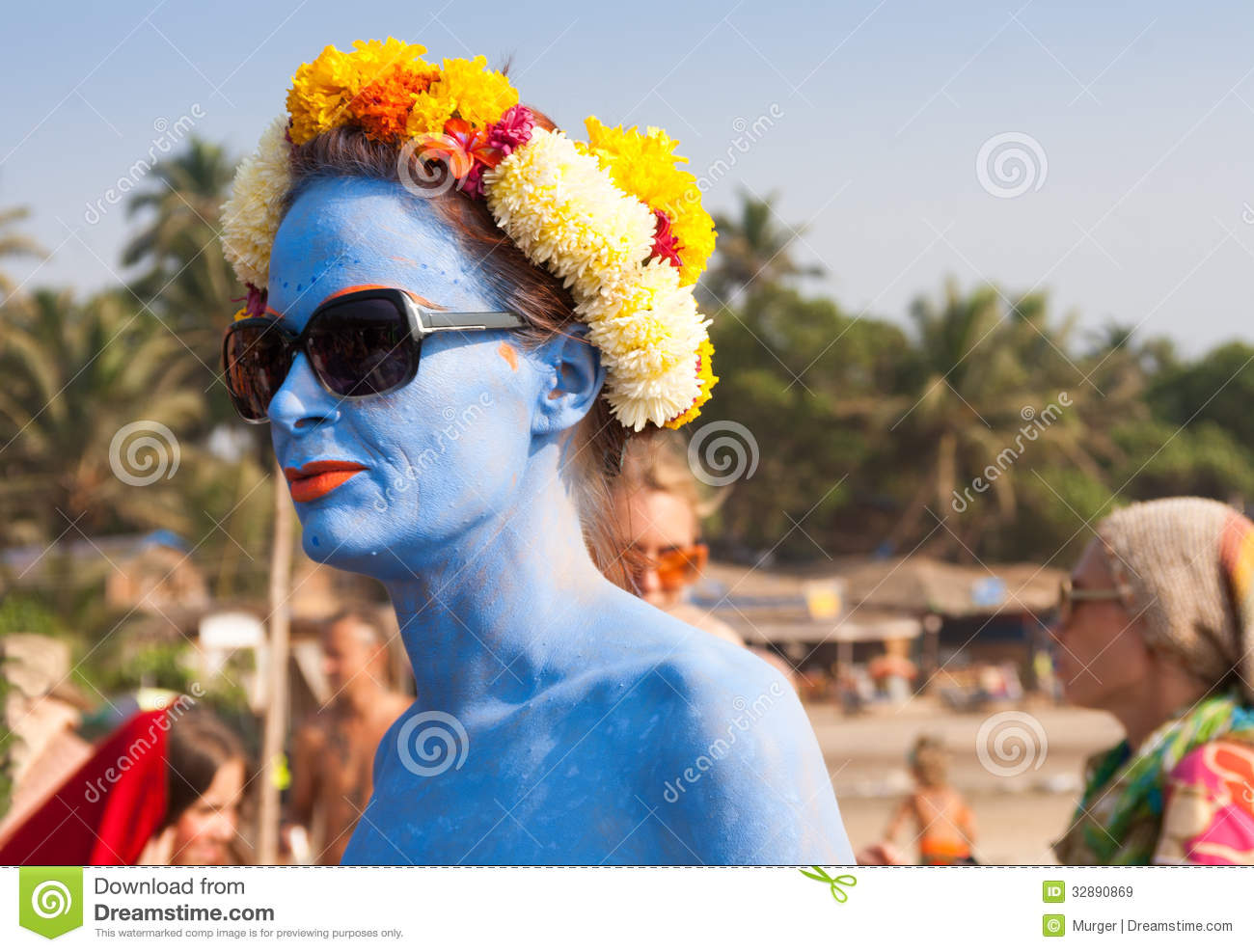 An Unidentified Woman With Blue Skin In A Flower Wreath At ...