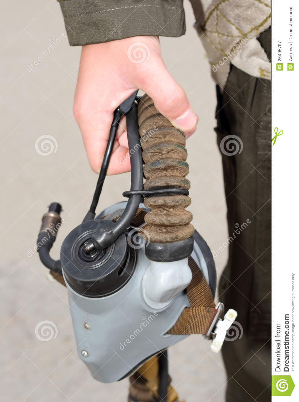 Uniforms, oxygen mask in his hand a military pilot