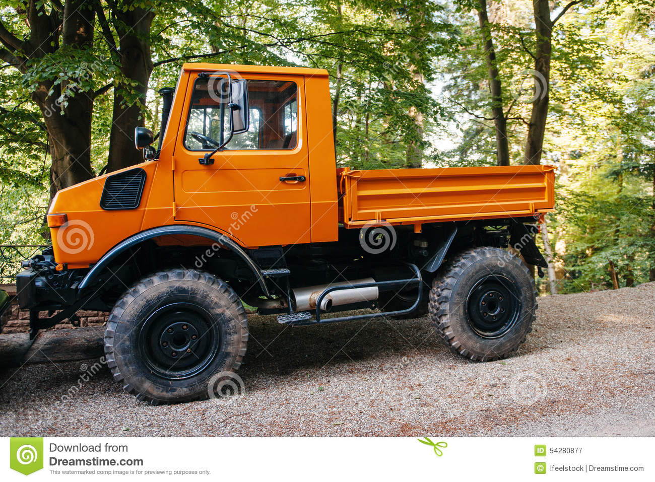 unimog four wheel drive vehicle as seen on a forest road. Black Bedroom Furniture Sets. Home Design Ideas