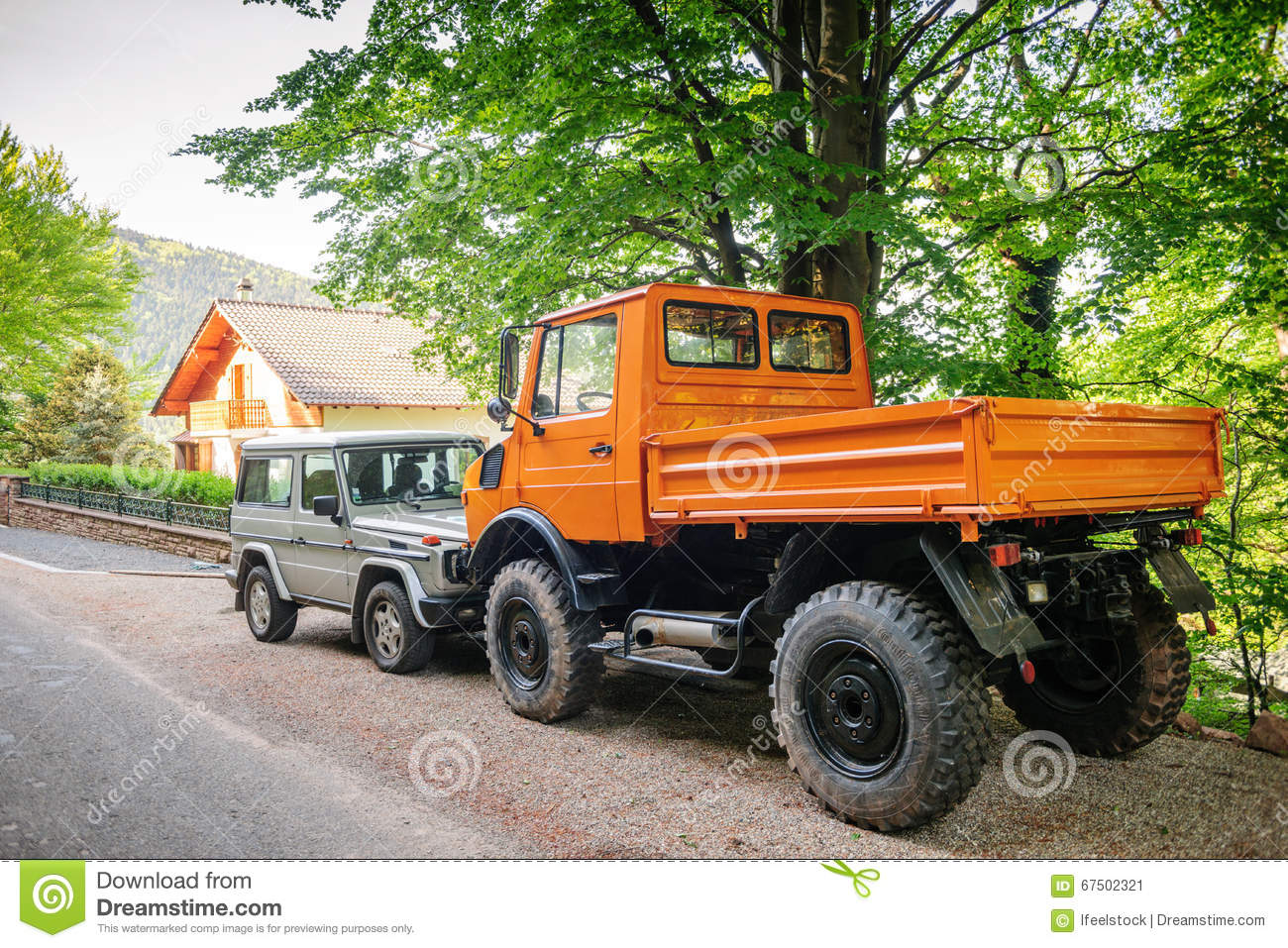 Unimog and mercedes benz g class suv stock photo image for Mercedes benz utility vehicle