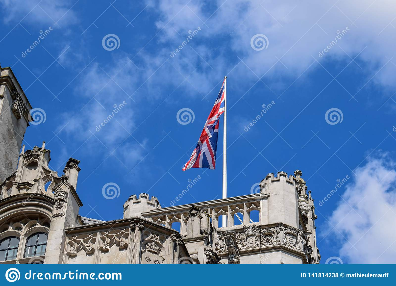 Union Flag (Union Jack) Waving in the Wind on a Rooftop in London