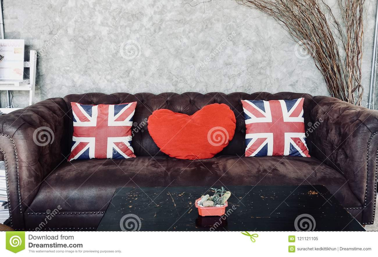 Amazing Union Jack Flag And Red Heart Pillow On Brown Sofa Pillow Alphanode Cool Chair Designs And Ideas Alphanodeonline