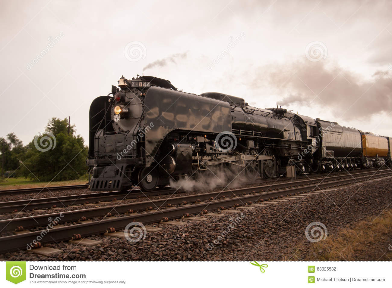 Union pacific train with freight neary grainery editorial